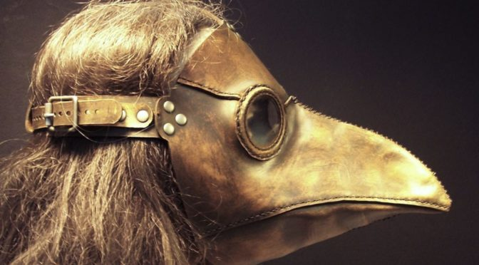 Profile view of woman wearing plague mask