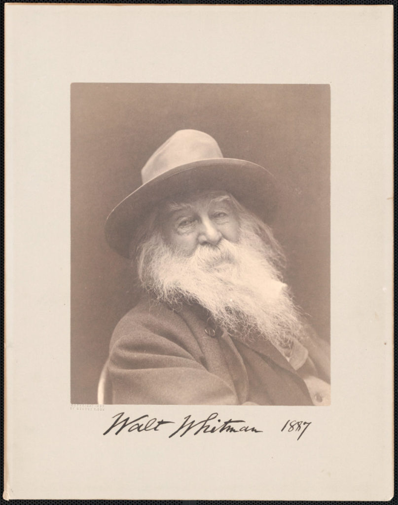 old faded photograph of bearded man in hat