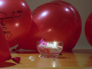 Photo of balloons and candle