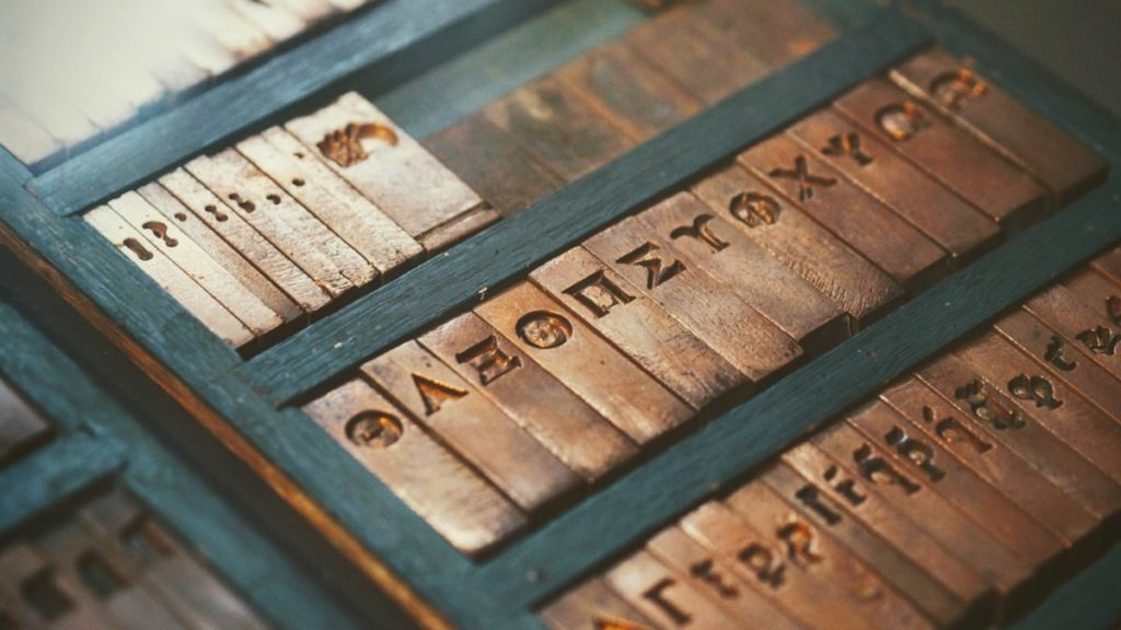 Brass letter plates in black wooden box
