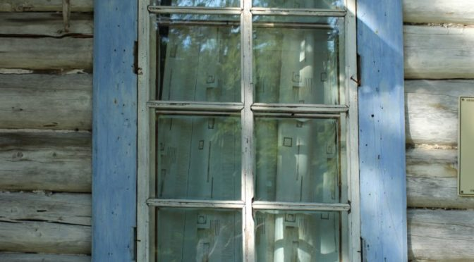 Photo of blue window trim in old siding