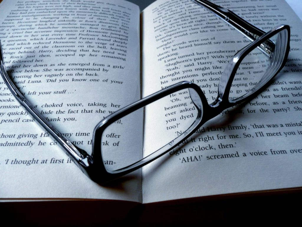 Photo of glasses sitting on open book