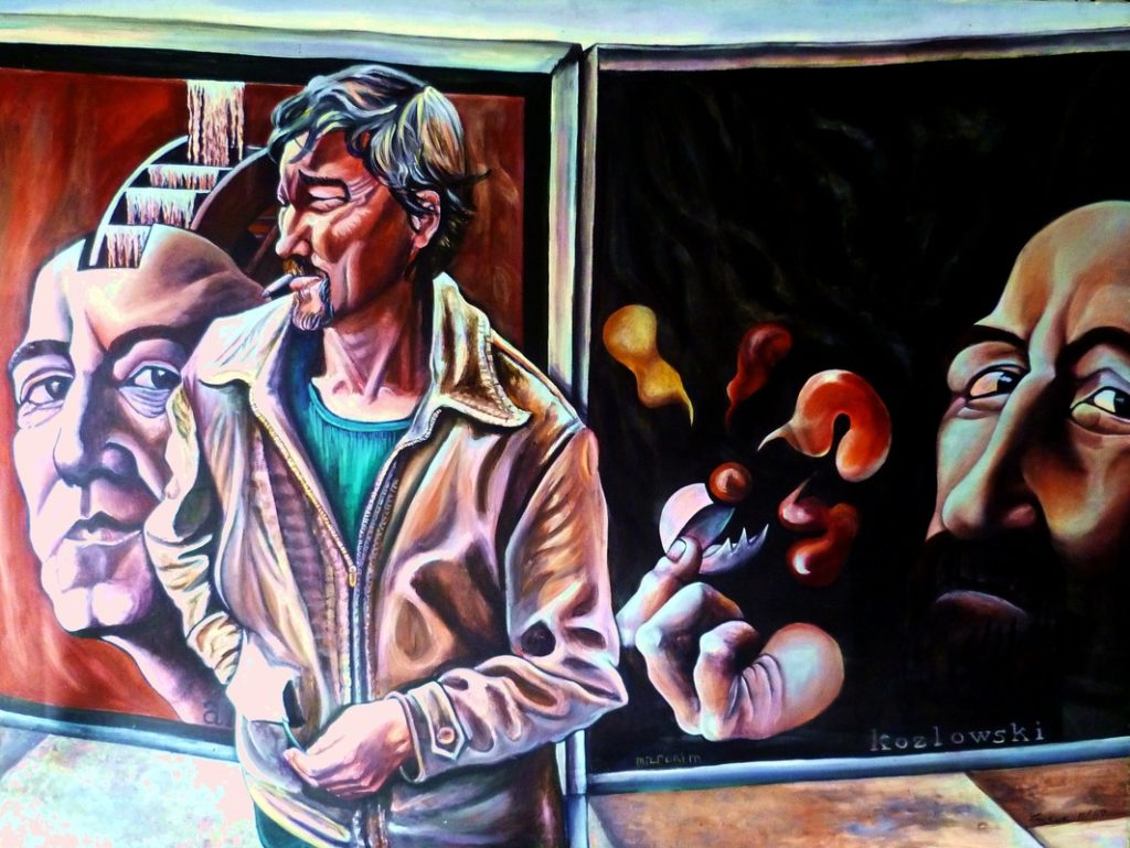 Painting of man in front of posters