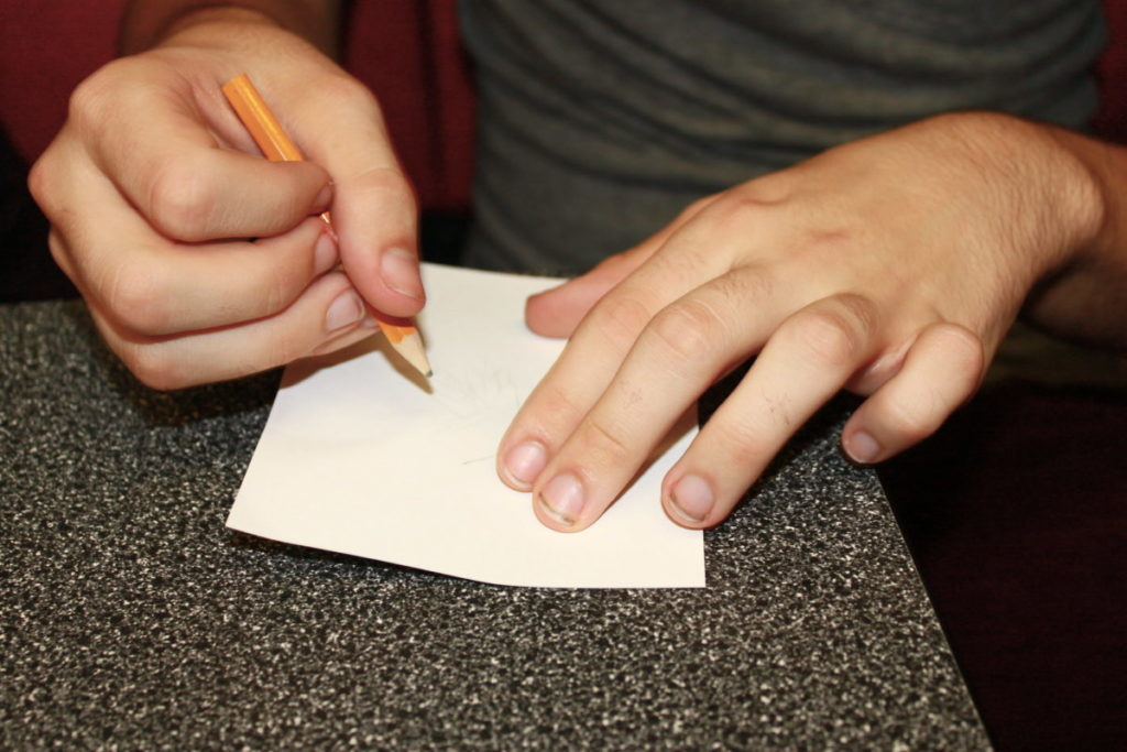 Photo of child's hands drawing