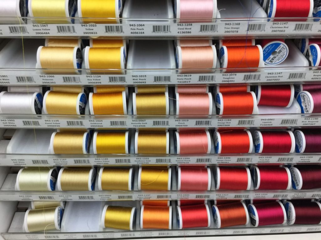 Photo of rows of colored thread