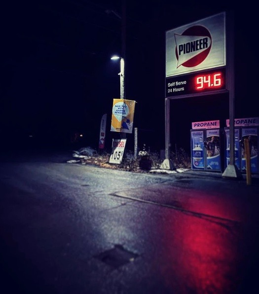 Photo of gas station at night