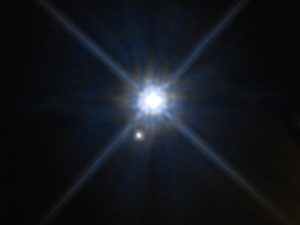 Light flaring against deep blue space