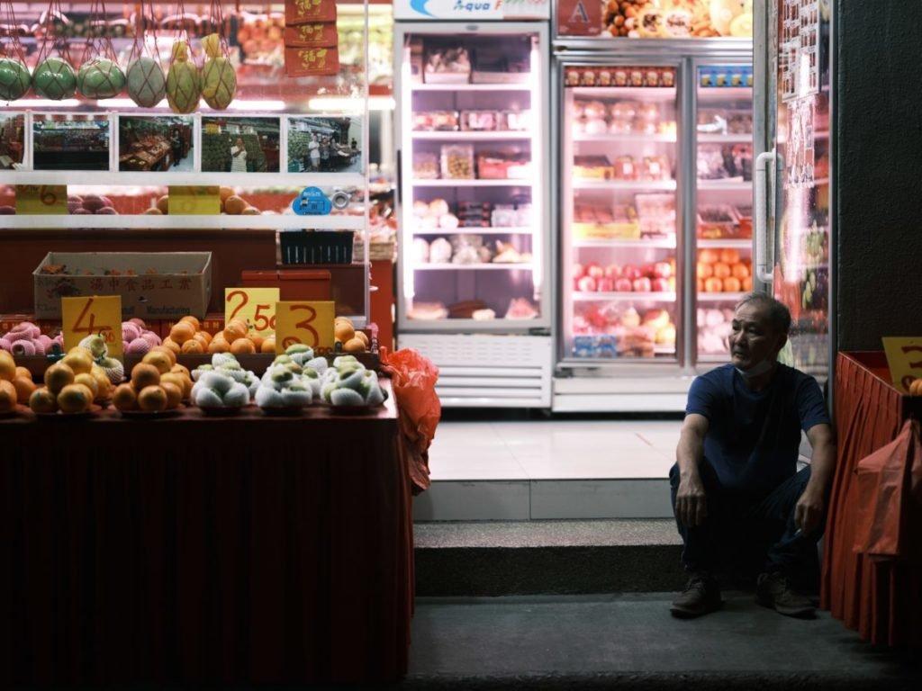 Photo of man in doorway of store