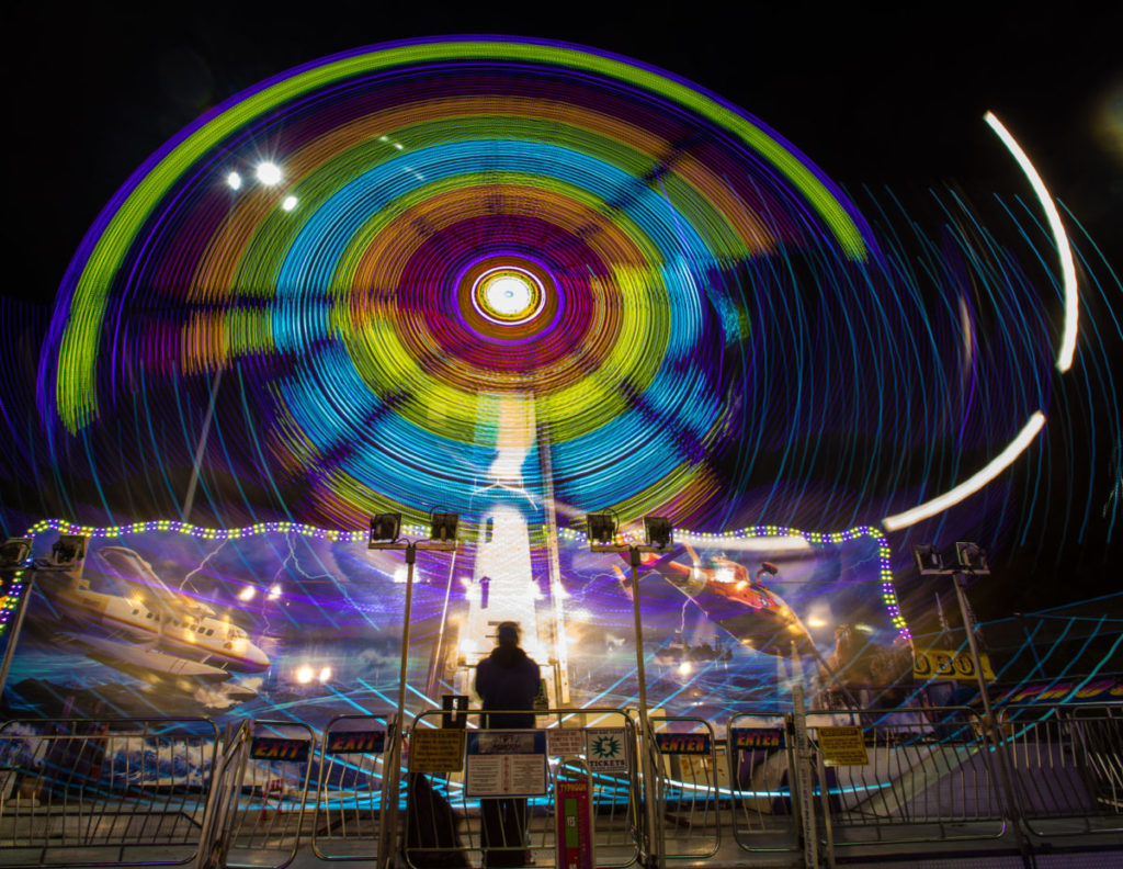 blue and purple light swirl at carnival
