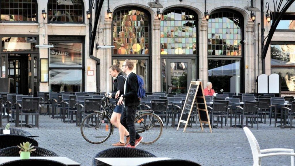 Photo of people walking down sidewalk
