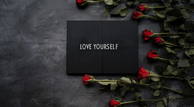 Photo of box that says Love Yourself and roses