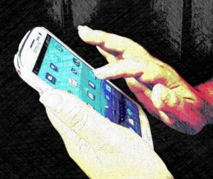 Photo of hands using cell phone