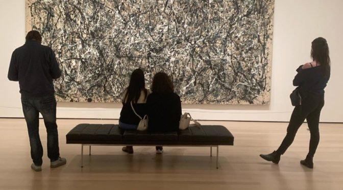 People looking at art in museum