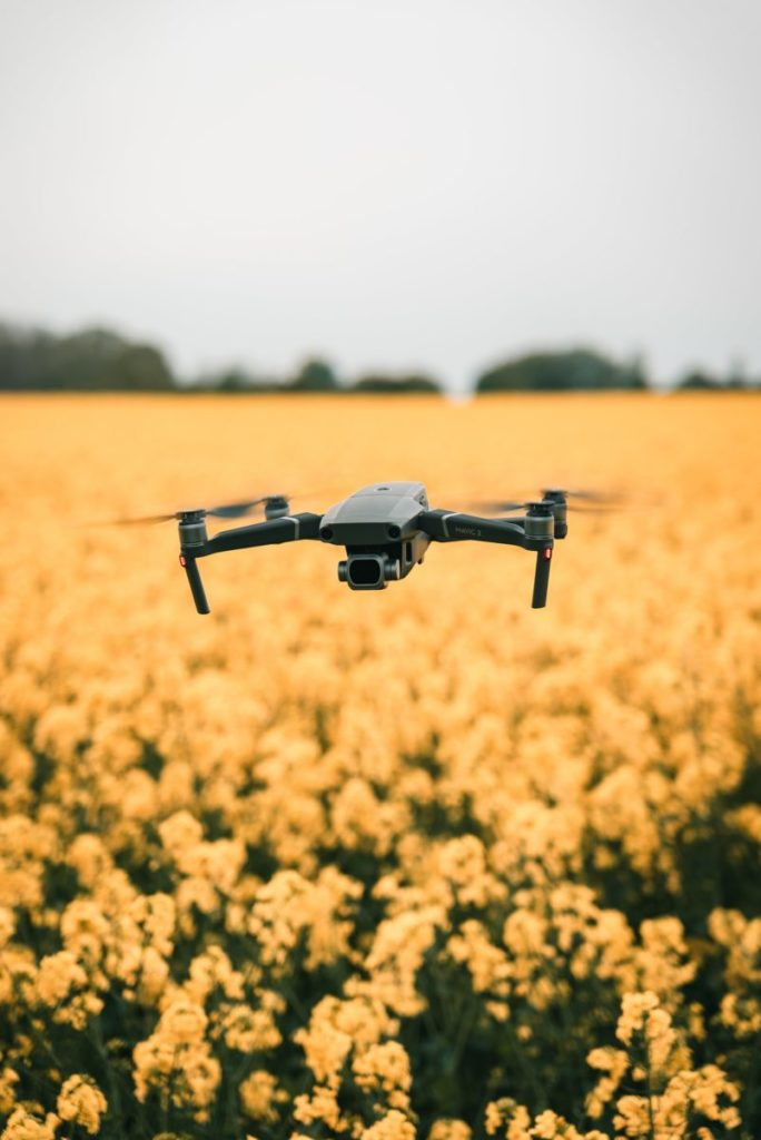 Photo of drone over field