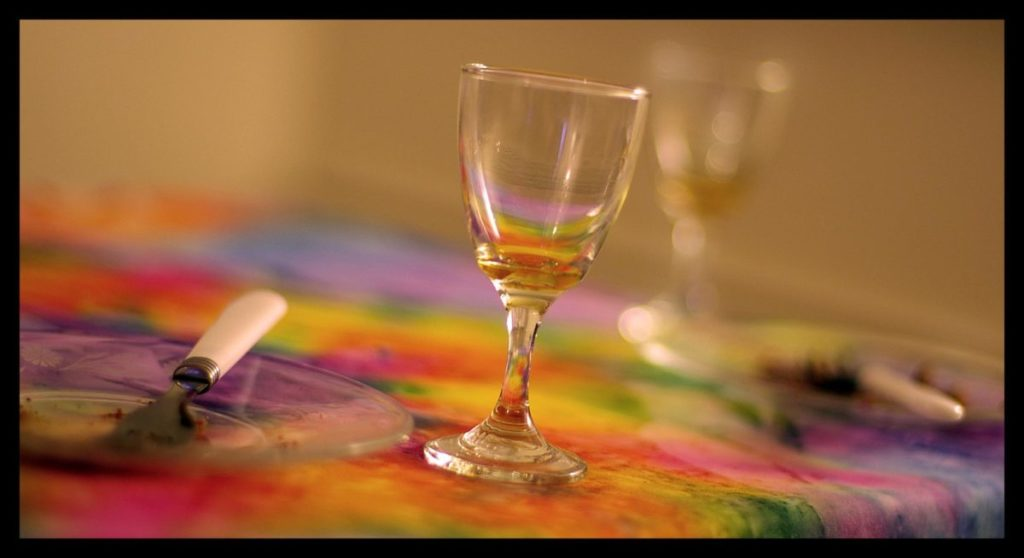 Photo of wine glass on colorful tablecloth