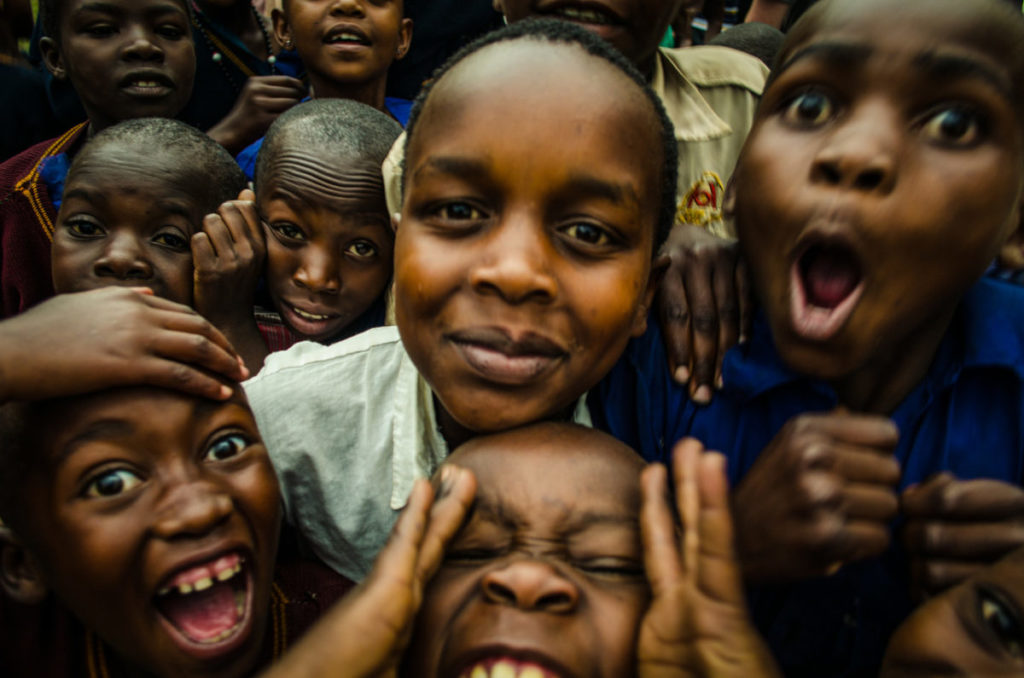 Photo of children making faces, laughing