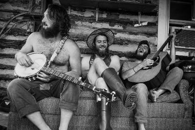 Photo of men on porch playing instruments