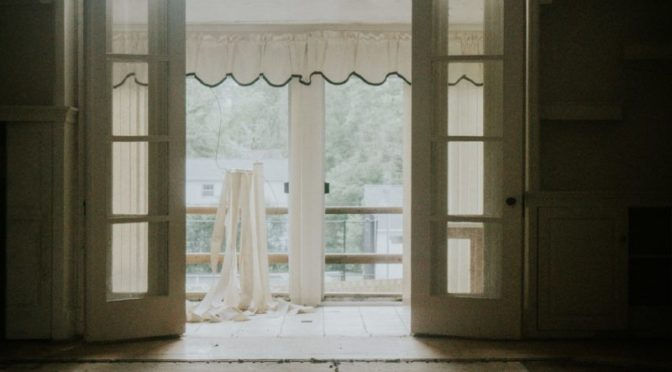 Photo looking through open french doors